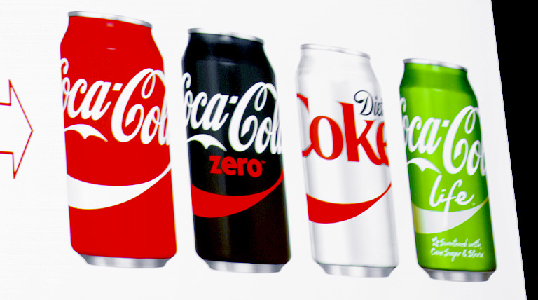 Unused can designs which featured a more prominent dynamic ribbon device