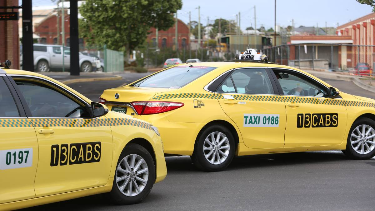 13CABS taxis with old livery
