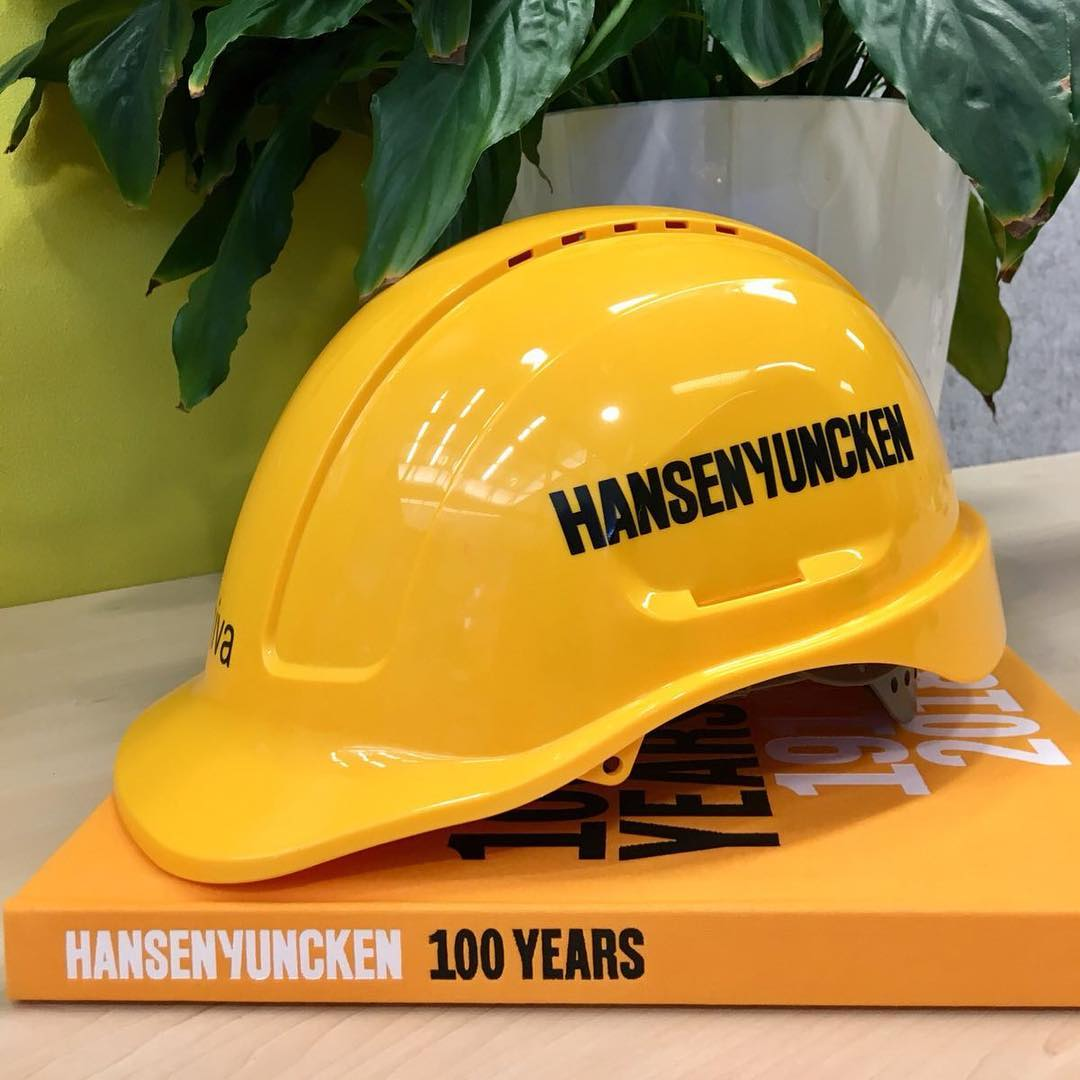 Hansen Yuncken hard hat and book spine